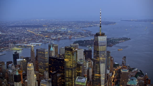 AERIAL Manhattan and Governors Island in the background at dusk Aerial shot of Lower Manhattan with the Governors Island in the background as the evening is setting in. Shot in NY, USA. wall street stock videos & royalty-free footage