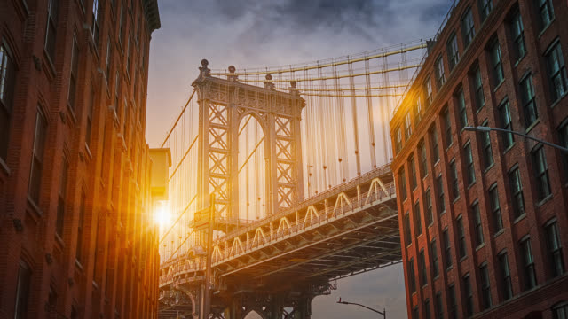 manhattan bridge and sunbeams between the buildings - american architecture stock videos & royalty-free footage