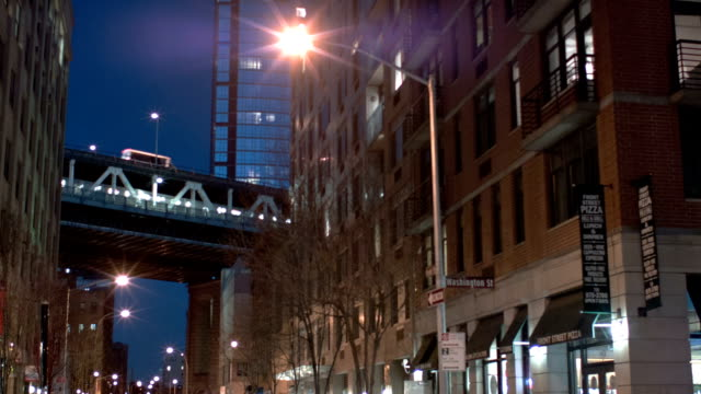 Manhattan bridge between buildings at night City background manhattan bridge stock videos & royalty-free footage