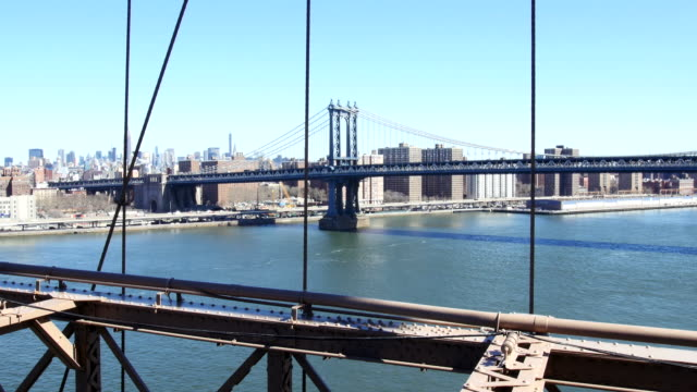 Manhattan Bridge in New York View on Manhattan Bridge from Brooklyn Bridge across East River manhattan bridge stock videos & royalty-free footage