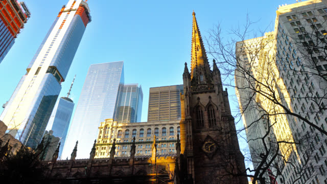 manhattan financial district. sky line. church. financial building - gothic architecture stock videos & royalty-free footage