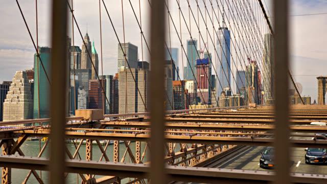 Manhattan Financial District through Brooklyn Bridge Cityscape neo gothic architecture stock videos & royalty-free footage