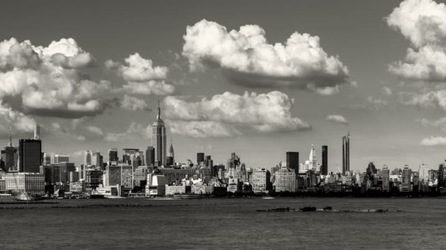 Manhattan Midtown West skyscrapers and Hudson River with passing clouds in Black & White. New York City Time-lapse - vídeo