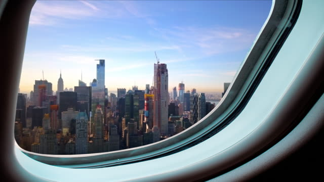 Manhattan seen from a plane's window 4k Traveling by airplane to New York City plane stock videos & royalty-free footage