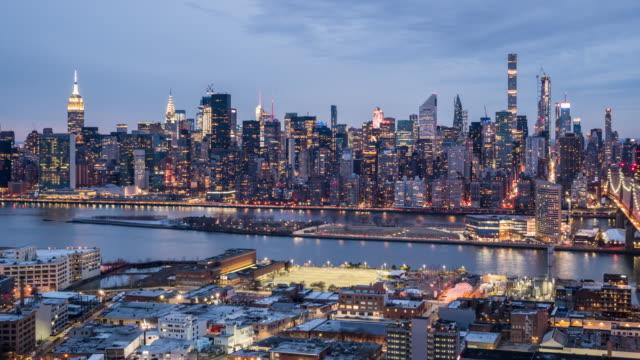 T/L WS HA PAN Manhattan skyline dusk to night transition / New York City, USA View of Manhattan skyline from dusk to night. new york city skyline stock videos & royalty-free footage