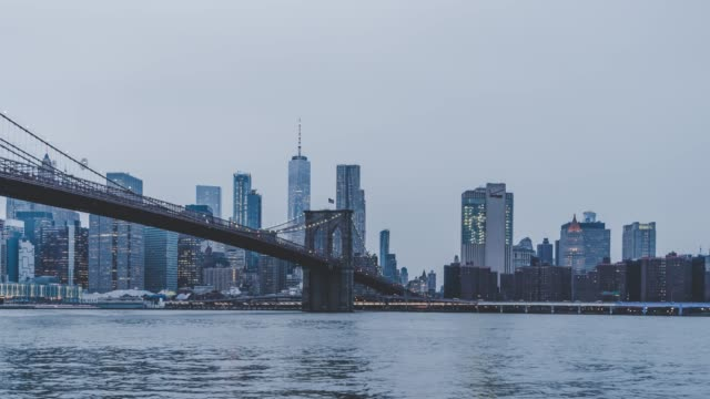 T/L PAN Manhattan skyline from Day to Night, Brooklyn Bridge Park, Brooklyn video
