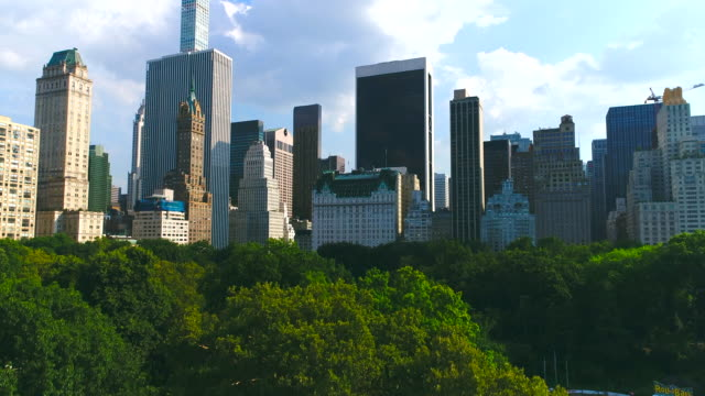 Manhattan skyline with Central park in New York city Aerial Manhattan skyline with Central park in New York city Aerial central park manhattan stock videos & royalty-free footage