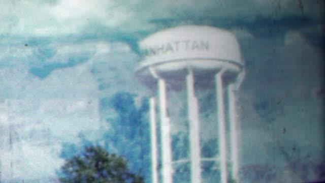 1958: Manhattan watertower double exposure film effect nature.