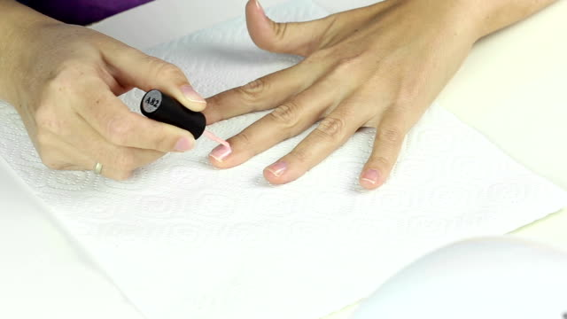 Manicure in process - painting gel polish video