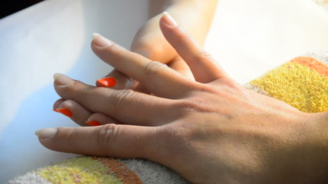 Manicure making, nile polishing and protection applying video