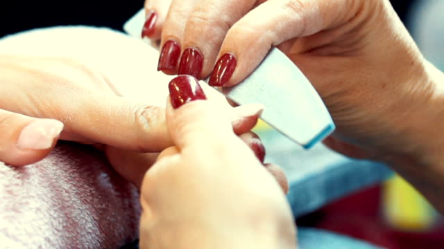 manicure procedure. - nail work tool stock videos & royalty-free footage