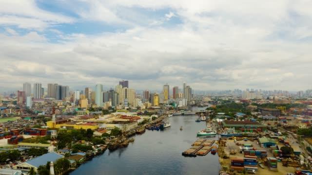 paesaggio urbano di manila con cielo blu e nuvole time lapse - filippino video stock e b–roll