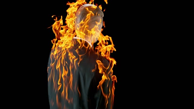 SLO MO LD Mannequin in a male business suit caught on fire