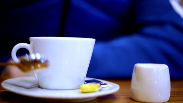 Man's hand holding a coffee cup Man's hand holding a coffee cup handful stock videos & royalty-free footage