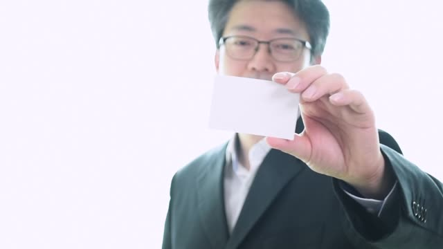 man's hand showing business card - closeup shot on white background. - business card stock videos & royalty-free footage