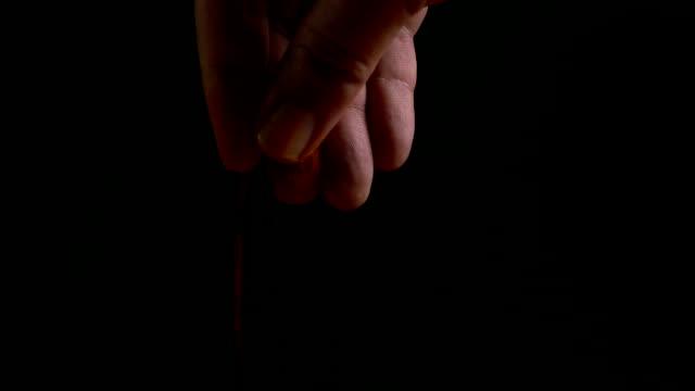 Man's hand sprinkling spice video