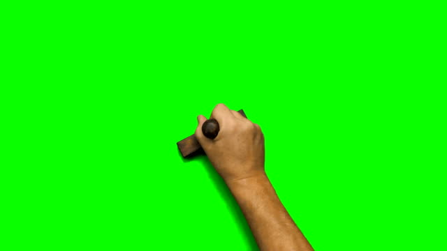 Man's hand stamping on green screen