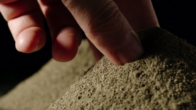 SLOW MOTION:Man's hand taking a pinch of black pepper powder from a pile SLOW MOTION:Man's hand taking a pinch of black pepper powder from a pile pinching stock videos & royalty-free footage