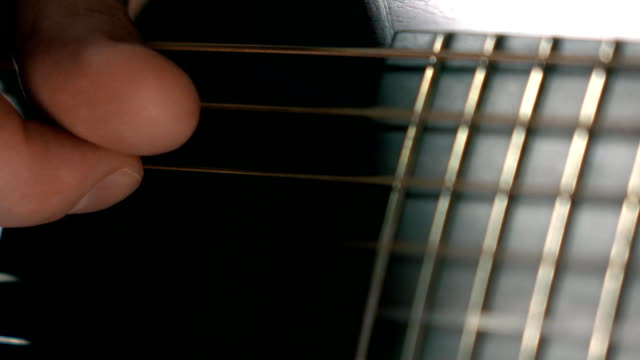 Man's hand touching strings. FullHD macro video video
