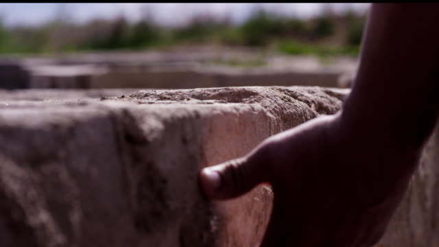 Man's hand touching wall outdoor - concept of native place. Close up of man touching wall - concept of memories about the place. Young man hand touching concrete wall Man's hand touching wall outdoor - concept of native place. Close up of man touching wall - concept of memories about the place. Young man hand touching concrete wall. handbook stock videos & royalty-free footage