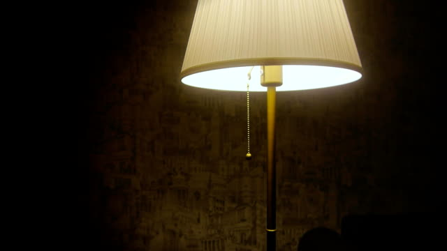 man's hand turn off the lamp - bedroom video stock e b–roll