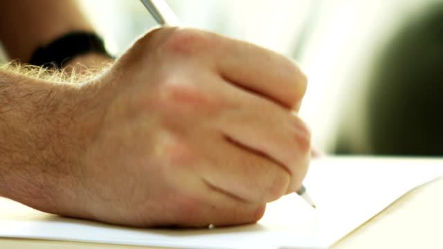 Man's hand writing video