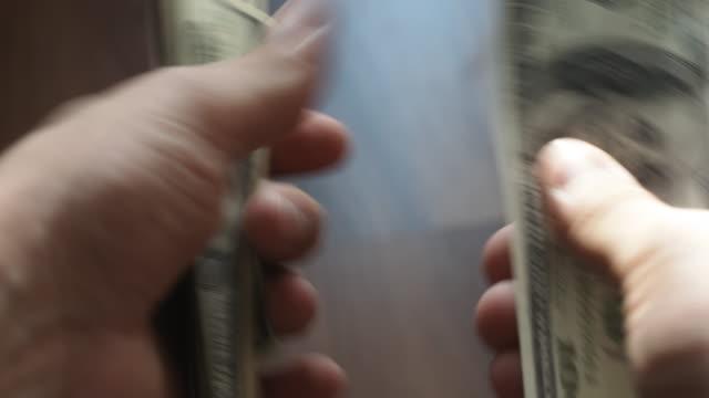 Man's hands counting hundred dollar bills video