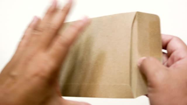 man's hands holding envelope with blank paper - kuvert bildbanksvideor och videomaterial från bakom kulisserna