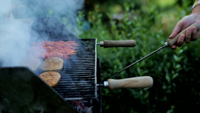 mans hands prepring food on grill mans hands prepring food on grill cooking utensil stock videos & royalty-free footage