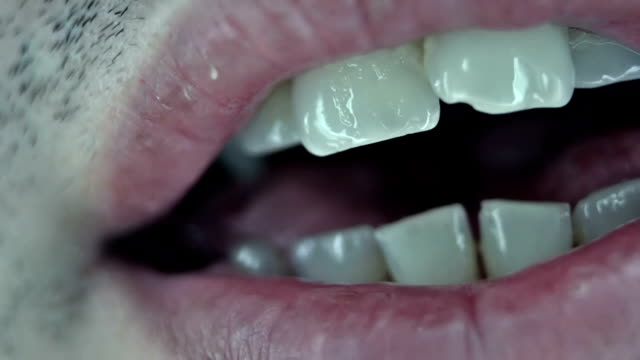 Man's mouth close up video