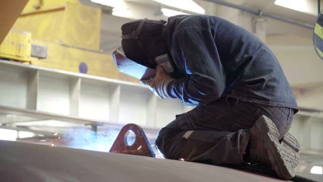 manual welding by worker on autoclave tube - autoclave video stock e b–roll