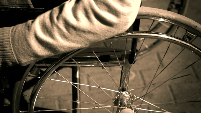 Manual Wheelchair Sepia close up of cropped disabled person starting his hand drive wheelchair sepia toned stock videos & royalty-free footage