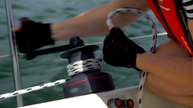 Manual winch for raising the sails on the boat. video