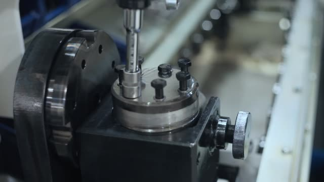 Manual worker assembling machine parts at production line Worker twisting bolts into industrial installation. Manual worker assembling machine parts at production line. Assembly of industrial unit. Close up of screwdriver twisting bolts in machine parts production line worker stock videos & royalty-free footage