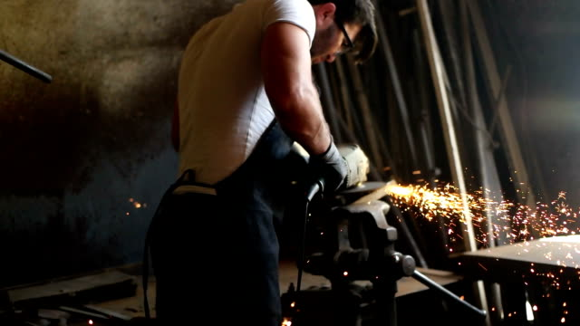 Manual worker on a workshop Manual worker on a workshop power tool stock videos & royalty-free footage