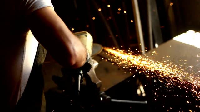 Manual worker on a workshop Manual worker on a workshop metal worker stock videos & royalty-free footage