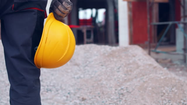 manual worker standing on construction site - ghiaia video stock e b–roll