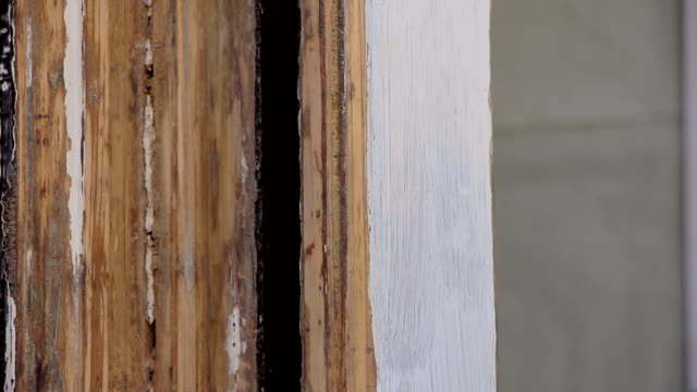 manually sanding wooden door frame - carta vetrata video stock e b–roll