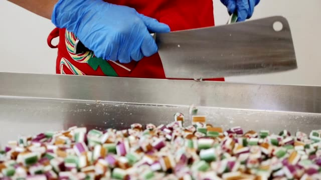 Manufacture of caramel sweets and candies Manufacture of caramel sweets and candies stick plant part stock videos & royalty-free footage