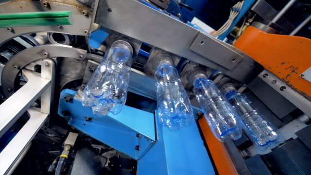 Manufacturing process at bottled water plant. video