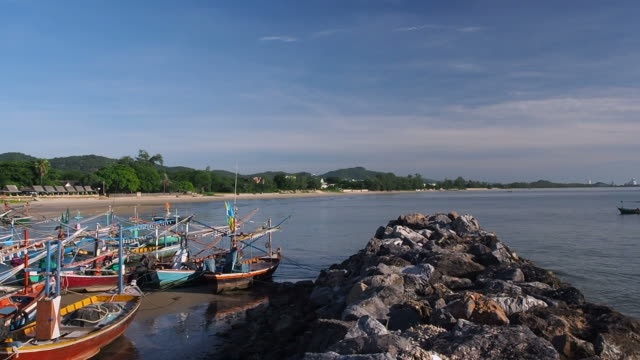 Many asian fishing boats moored on the beach