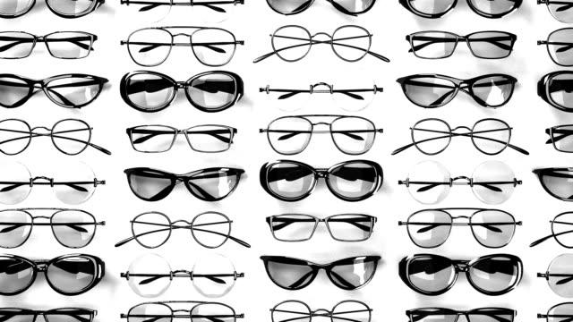 stockvideo's en b-roll-footage met veel zwarte bril op witte achtergrond - bril brillen en lenzen