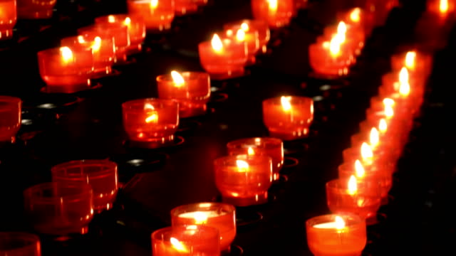 Many burning candles in christian church video