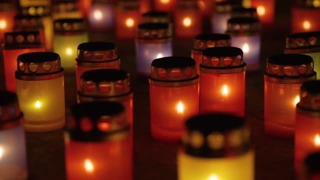 Many burning lanterns on memory, close up footage video