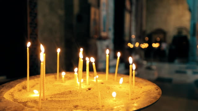 Many Candles Burning in a Church video