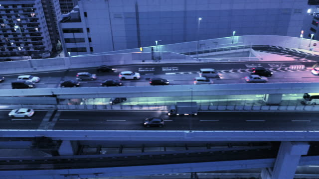 Many cars running on the elevated driveway