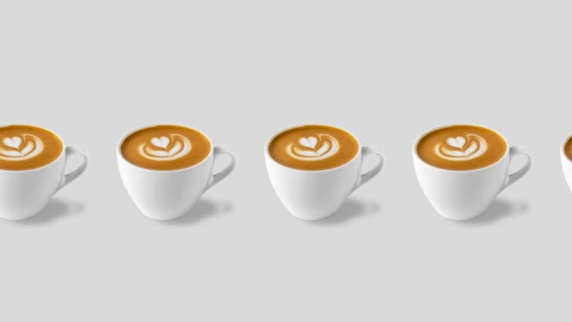 many coffee cups with rosetta latte art isolated on a white background