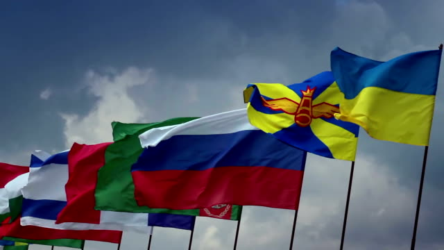 Many countries flags on flagpoles. Ukrainian, Russian, Turkmen. Union, politics video