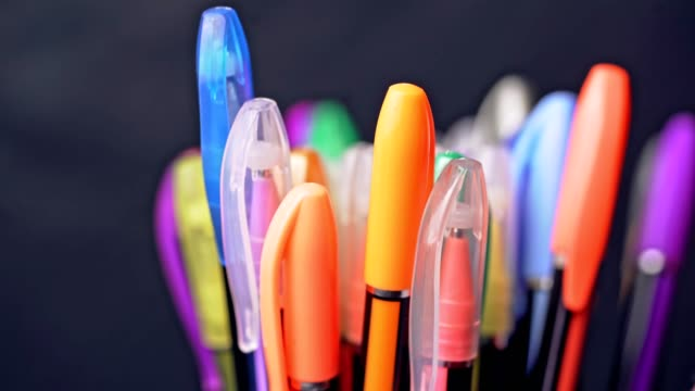 Many different colored pens.
