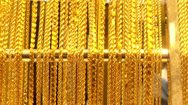 Many different gold chains.
